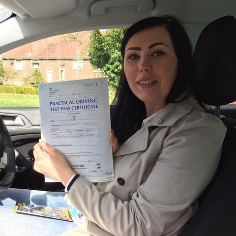 woman with driving certificate in her hands